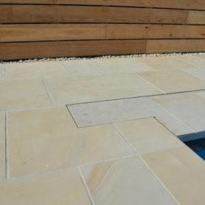 Danebury Sandstone paving with a pit lid detail