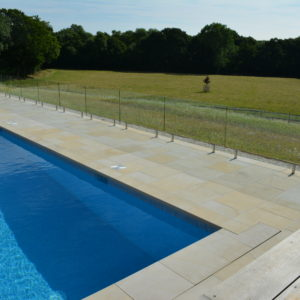 Danebury Sandstone pool paving with a pit lid
