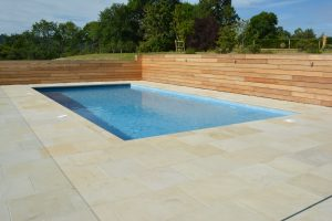 Danebury Sandstone pool surrounds. Mix pack paving