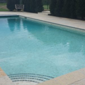 Downton Pool surround with steps into pool