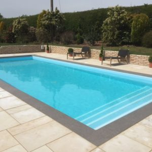 Namur Porcelain pool coping with Danebury Honed Sandstone pool paving