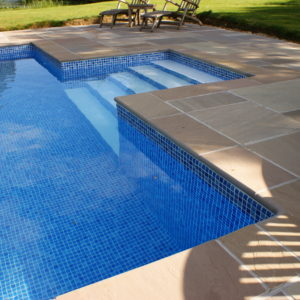 Raj Riven Sandstone pool copings with Bullnose edge and matching paving surround