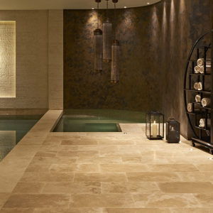 Travertine Honed & Filled pool and spa surrounds with matching tiles. Lorena limestone wall cladding