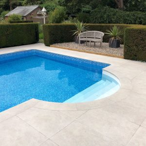 Portland Cream Bespoke Roman End Porcelain pool coping and non slip paving/ terrace.