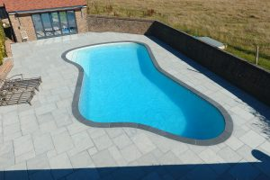 Chattis Black Bespoke Freeform Outdoor Pool Coping made to size.
