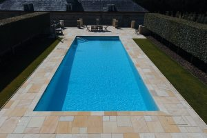 Cotswold Mint Riven Sandstone Outdoor Swimming Pool Coping and Paving Terrace.