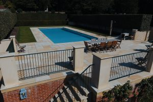 Cotswold Mint Riven Sandstone Outdoor Swimming Pool coping, terrace paving and bespoke step treads.