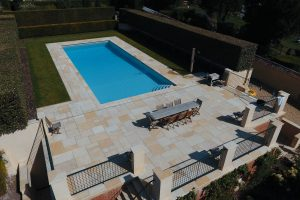 Cotswold Mint Riven Sandstone Outdoor Swimming Pool Coping and Paving.