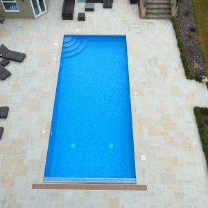 Danebury Sawn Sandstone Outdoor Swimming Pool copings and terrace paving.
