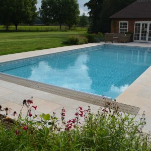 Fossil Pearl Tumbled Outdoor Swimming Pool Coping and Paving.