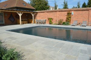 Georgian Grey Antiqued tumbled Sandstone pool coping and Paving.