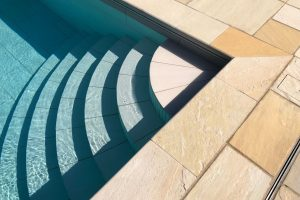 Cotswold Mint Riven Sandstone Swimming pool coping.